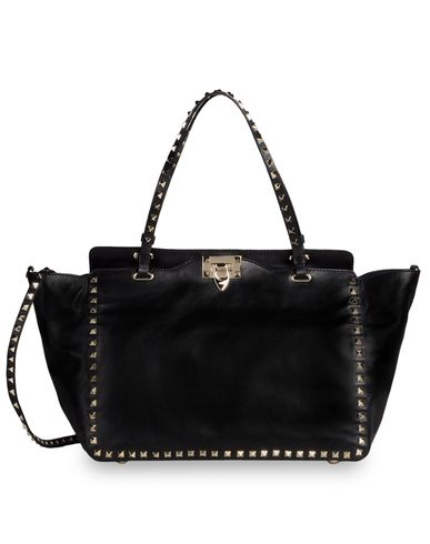 Studded leather accessories, such as this geometrically interesting bag, continue even bigger going forward.