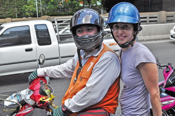 Nan wears a helmet on one of two motorcycle rides in Bangkok, Thailand, her first-ever.