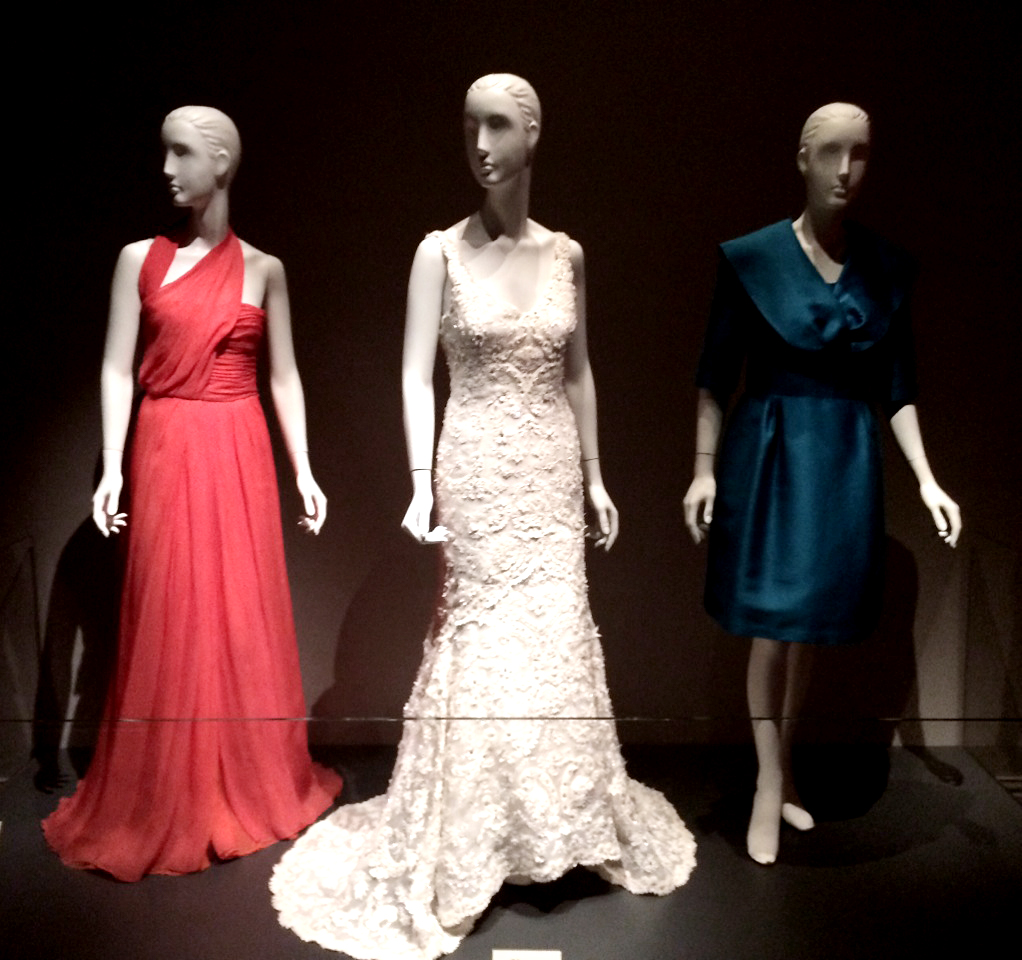 Left to right: Red evening gown worn by the Bushes' daughter Barbara, Jenna Bush's richly embroidered wedding gown, and the blue silk suit Laura Bush wore to Jenna's wedding