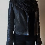Black leopard print scarf under leather jacket