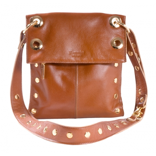 """2. Cross-body Hammit handbag.  This entrepreneurial Los Angeles company produces bags that are a unique blend of a rock and roll vibe combined with a passion for practicality.  Sturdy soft leather is meant to stay with you until the bag is vintage. Bags are adjustable as shoulder bags to clutches to cross-body, a necessity for savvy security-conscious traveling women.  Various reinforced pockets and zippers hold all your """"stuff.""""  For some reason these bags just feel good, and the compartments are fun to play with."""
