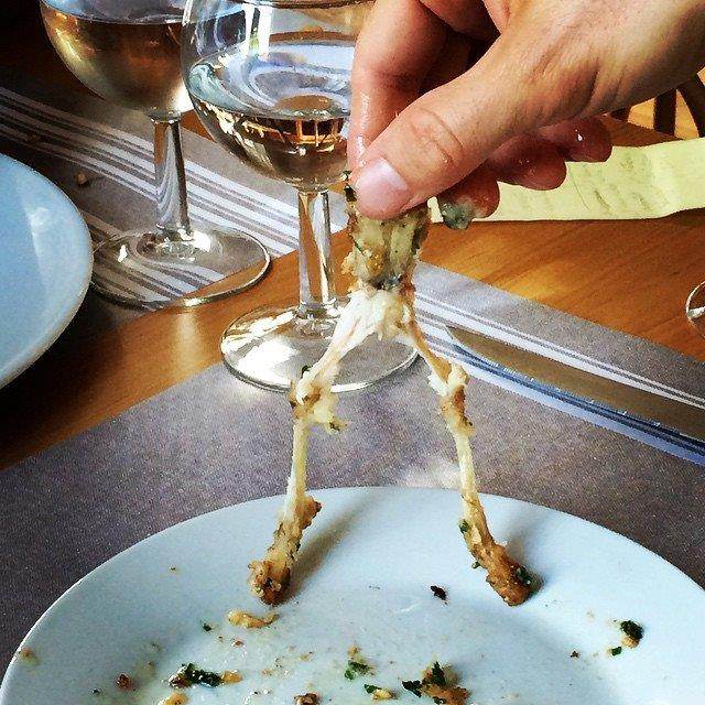 My husband Sam Parades cleaned his plate of frog legs.