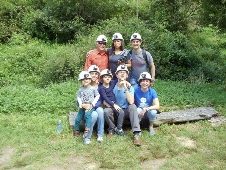 All eight of us, outfitted with hard hats and headlights for caving.
